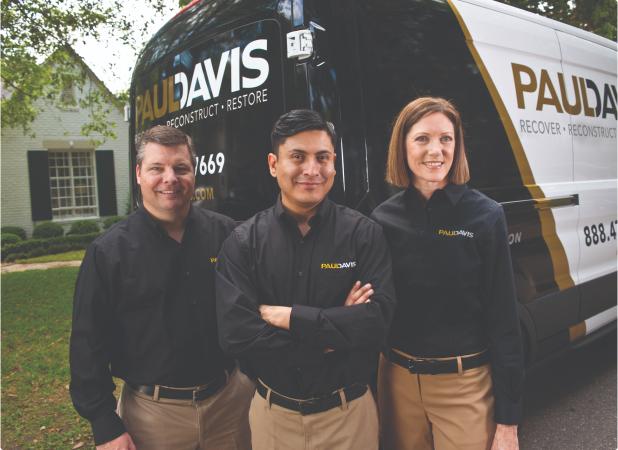 Paul Davis team in front of a van